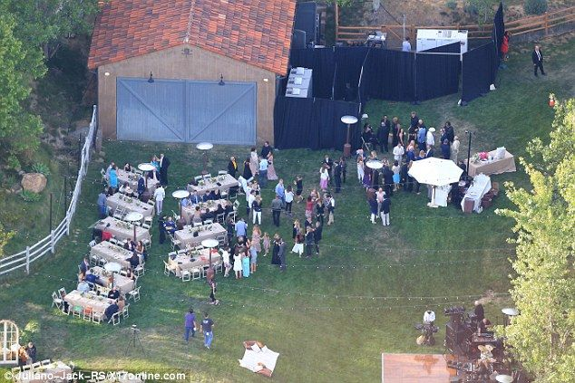 What a delight: Elegant table settings were laid out in the field where guests mingled with one another #IanSomerhalder-