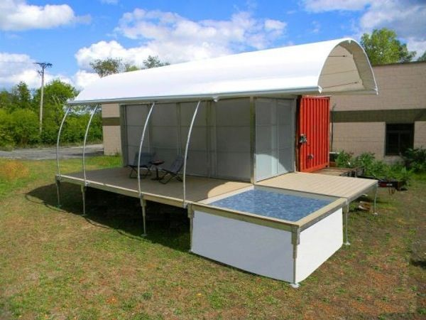 This innovative shipping container home measures 500 square feet including the deck space, and is located in Lake Geneva, Wisconsin. It comes complete with a small dipping pool and would make a great beach home or lake cabin. While this small home can be hooked up to utilities, it is designed to also function completely off the grid.