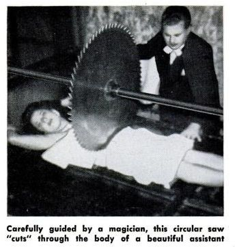"""Carefully guided by a magician, this circular saw """"cuts"""" through the body of a beautiful assistant.    FYI"""