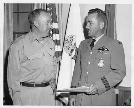 RCAF veteran Jim Ashworth of British Columbia is on the right, receiving a Certificate of Achievement for Services Rendered at NORAD (North American Aerospace Defence Command), from Brigadier-General McColpin of the U.S. Air Force at NORAD Headquarters in Colorado Springs on July 13, 1962.