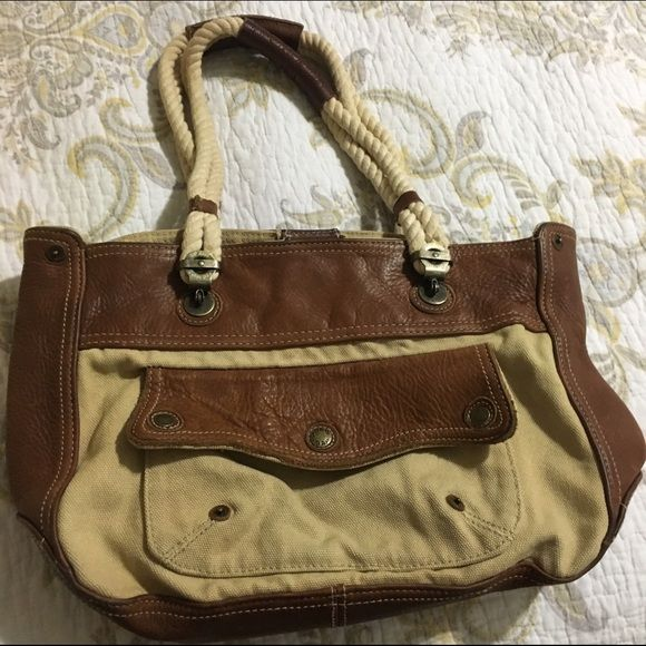 Gap purse Gap purse. Leather and material. Great preowned condition. GAP Bags