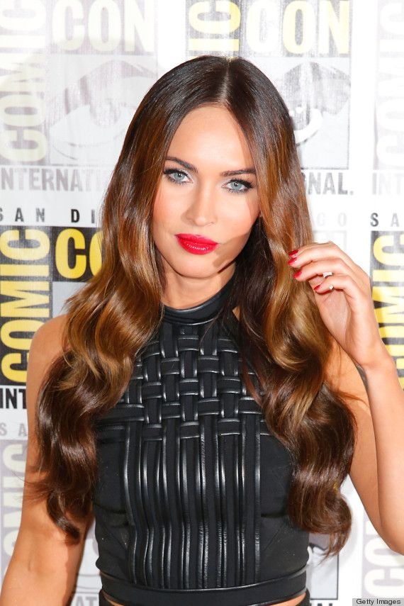 Megan Fox looks stunning with her shiny, brown waves, wispy eyelashes and glossy red lips that match her manicure.