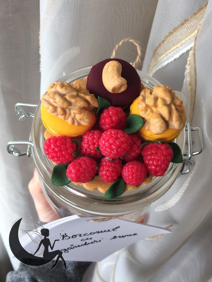 Raspberries, nuts and macarons made from polymer clay