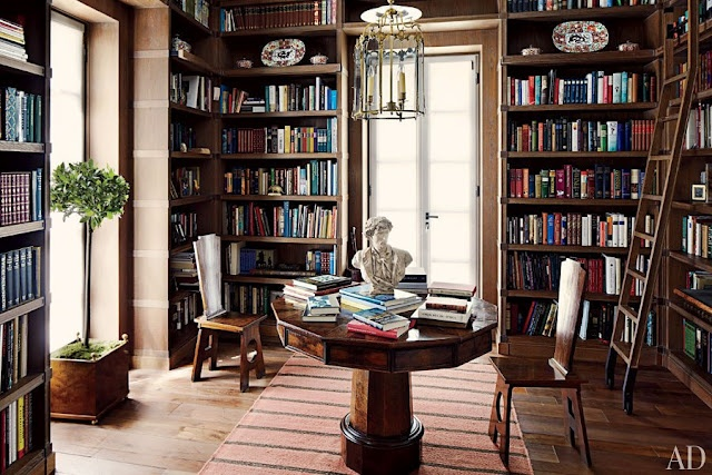Love this library table with the bust