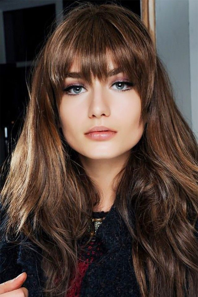 Choppy, straight-across bangs give off a retro vibe.