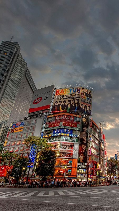 tokyo_road_buildings_people_evening_  Because there's KAT-TUN's BTR Tour billboard there. hahaha!