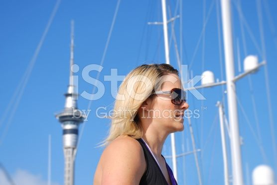 Woman Jogging past Auckland's Sky Tower, New Zealand royalty-free stock photo