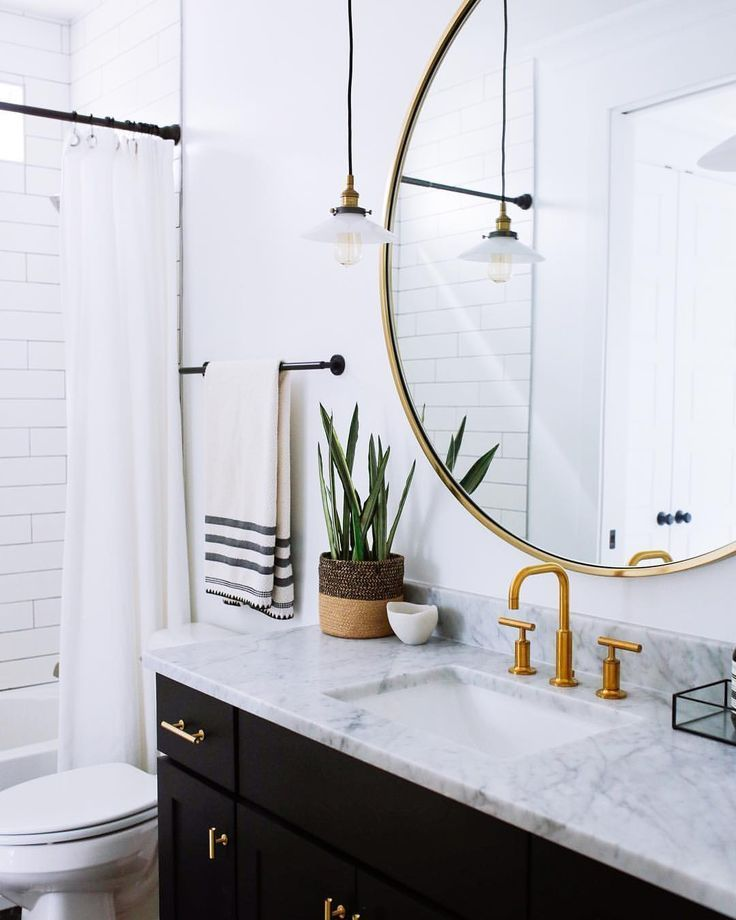 Mid Century Modern Bathroom With Black Cabinets Gold Fixtures
