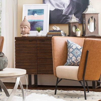An effortless blend of rustic style and midcentury modern flair, this eye-catching sideboard features a warm brown finish and chic ridged design. Use it as a stage for bold abstract accents in the den, or set it in the dining room to keep serveware essentials stowed away in style.