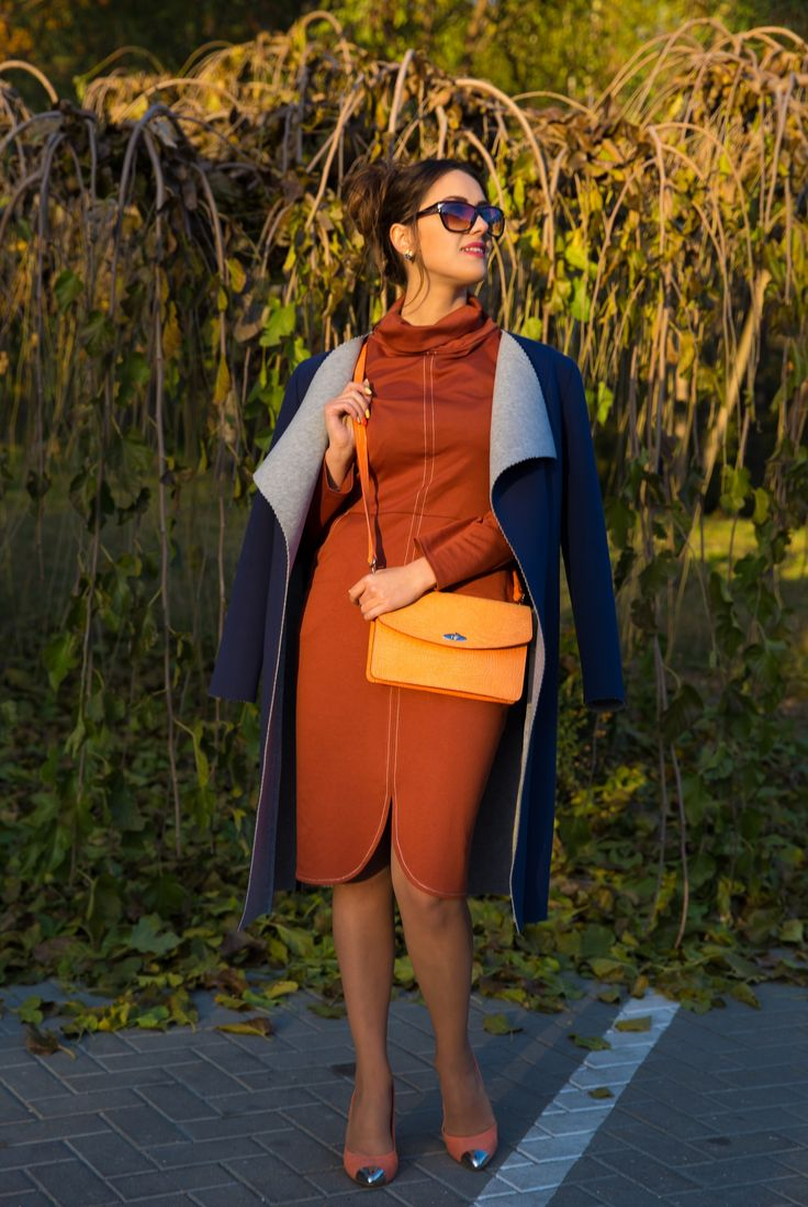 Shop this look on Lookastic:  https://lookastic.com/women/looks/coat-sheath-dress-pumps/14869  — Navy Coat  — Orange Leather Crossbody Bag  — Orange Sheath Dress  — Orange Suede Pumps  — Brown Sunglasses