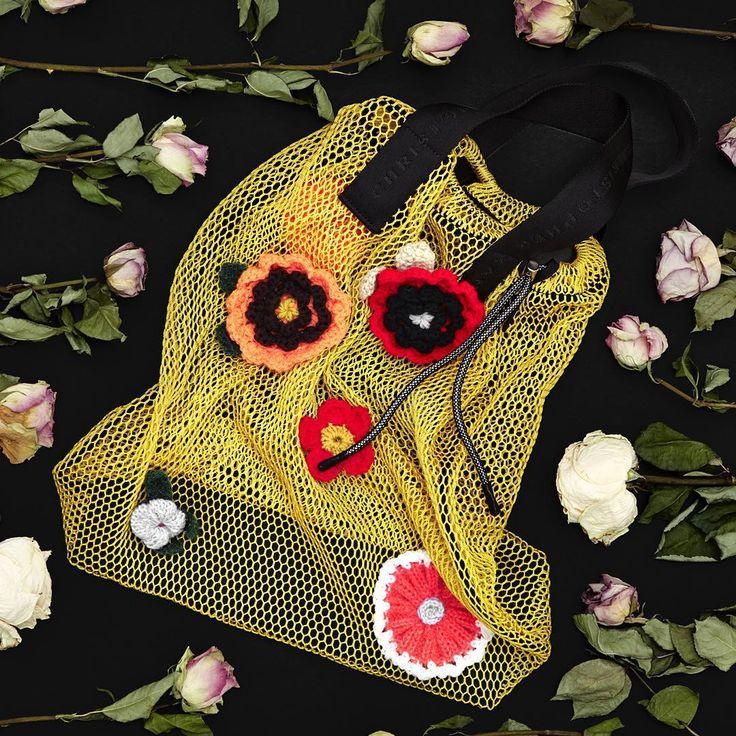 "1,374 Likes, 11 Comments - Christopher Kane (@christopherkane) on Instagram: ""Featuring hand made crochet flower details, the Autumn Winter 16 mesh drawstring shopper is now…"""