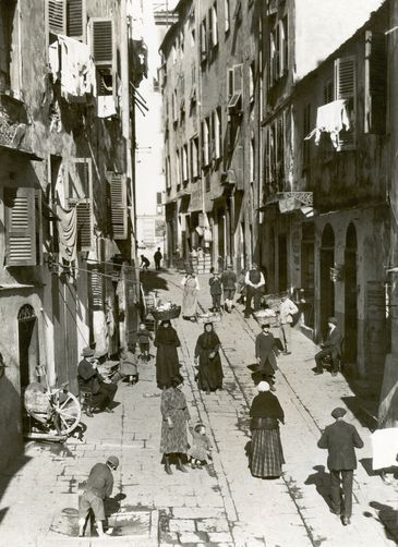 Street scene with tenements in the old section of Bastia. 1920s