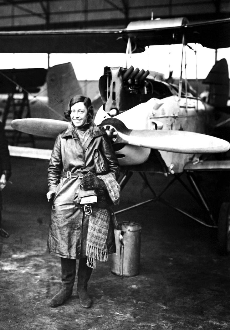 c. 1935  English aviatrix Amy Johnson (1903-1941) shown at a landing in Berlin. She was the first woman to make a solo flight from London to Australia in 1930.