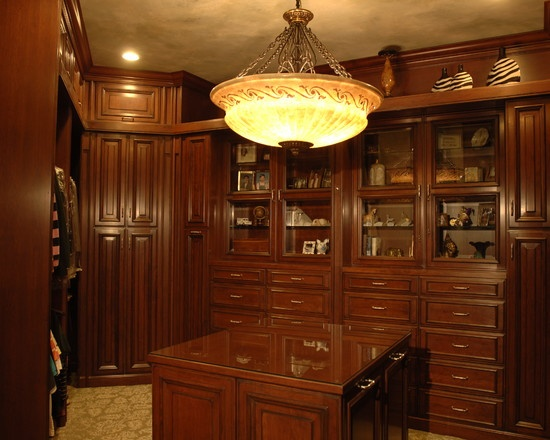 Lift door cabinets at the ceiling line stored little used items which required a step ladder with its own storage area designed by grace coffman at