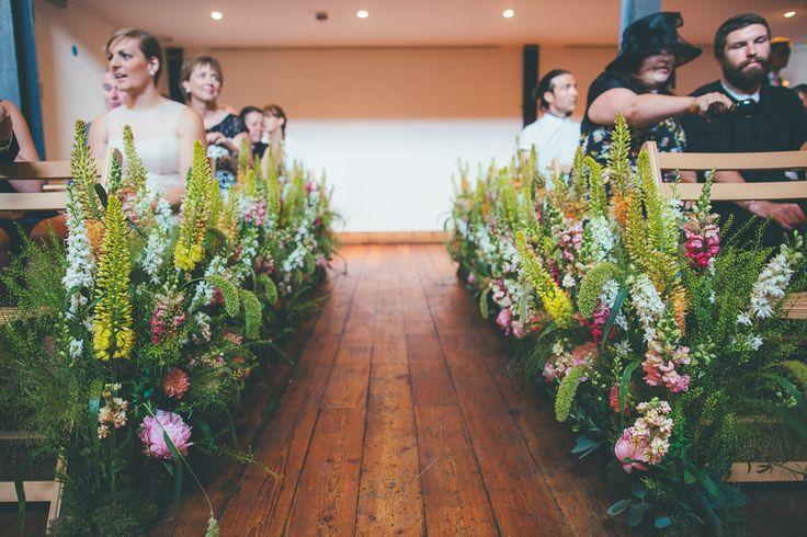 Botanical Aisle adorned with Flowers | Laure de Sagazan Wedding Dress…