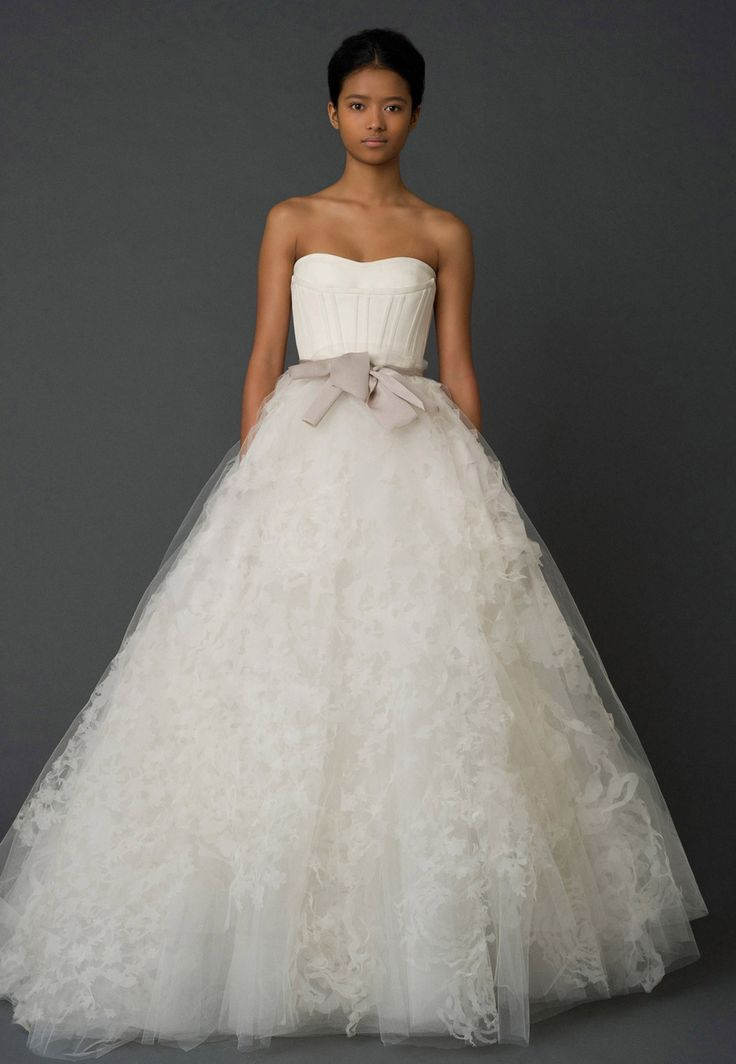"""""""Hannah"""" is an iconic Vera Wang design. Classical elegance with modern detailing. A-line silhouette reminiscent of a ballerina. Beautiful laser-cut floral organza layer the romantic skirt. Comes with"""