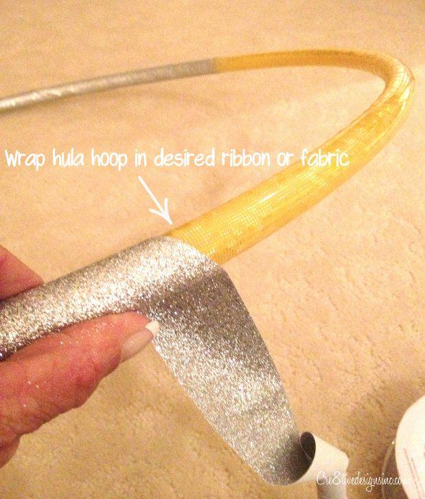 Wrap hula hoop with ribbon