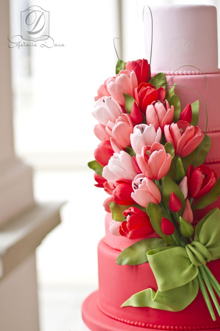 Gorgeous tulips on an ombré wedding cake