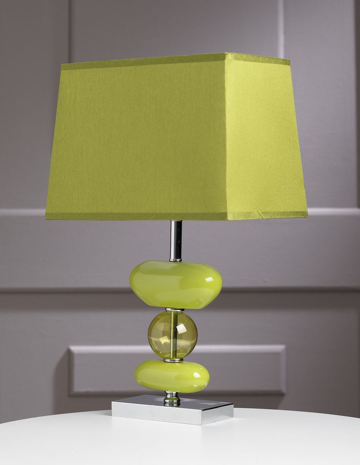 This is an elegantly styled designer lamp; the stand features 3 abstract coloured shapes, one on top of the next, the central one being circular and partly transparent; they sit on a chrome finished base, and the lamp comes with a matching rectangular shade.
