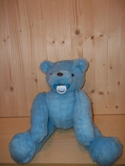 Teddy Bear, soft toy, wiht jointed head, arm, leg. It has a pacifier in his mouth that you can remove.   Cute, Cuddly Friend for your Baby.