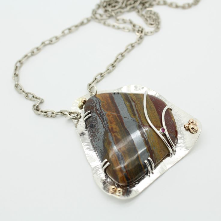 Necklace pendant. Sterling silver, rock, 14k yellow gold, CZ