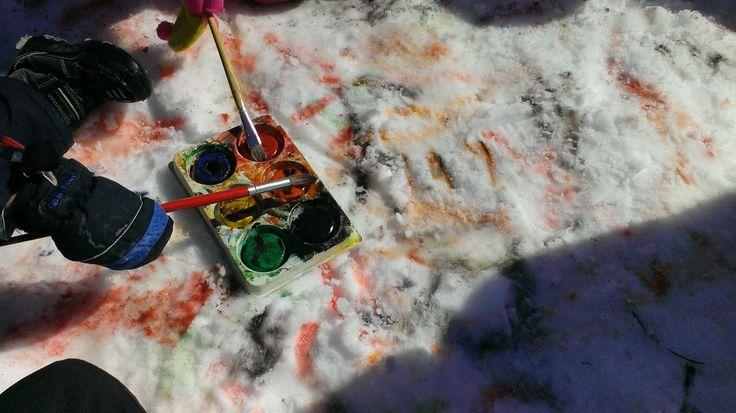 Painting snow with tempra blocks.