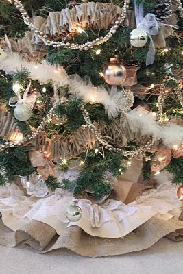 Great tutorial on how to make this amazing Christmas tree skirt from muslin, burlap, and lace. Now if only I could learn how to sew.