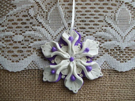 One-of-a-kind purple polymer clay snowflake. Eight inch white ribbon attached to the top for hanging. This ornament comes in a custom made gift box. Your ornament will be shipped with 1-3 day priority shipping. 3.25 long and 3.25 wide