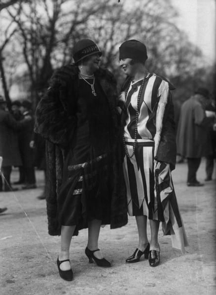 """A long waisted dress in broad contrasting stripes worn with a cloche-hat and high-cut court shoes. The other outfit is worn with a cloche hat with a small brim and single-bar high-heeled shoes, both by Louise."" #vintage #fashion #1920s"