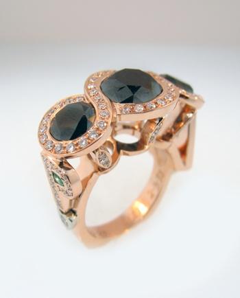 Custom rose gold ring designed by Mark Schneider.