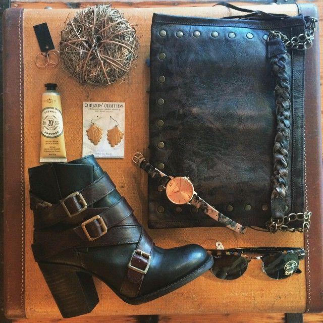 Studded worn-wash leather handbag, Olivia Burton watch and Raybans