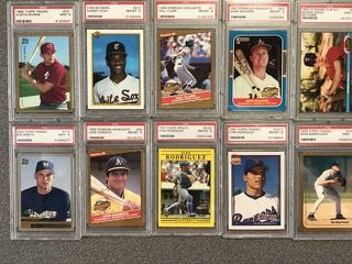 """LOT OF SEVENTEEN ROOKIE BASEBALL CARDS GRADED AND """"SLABBED"""" BY PSA AS NM-MT OR BETTER INCLUDING HALL OF FAMER IVAN RODRIGUEZ AND FUTURE HALL OF FAMERS, SAMMY SOSA, MARK MCGWIRE AND JOSE CANSECO"""