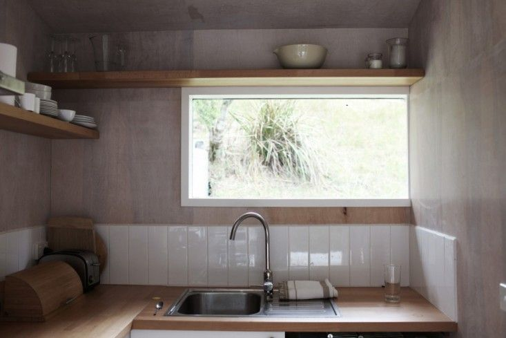 The kitchen in Anthony and Phoebe Dann's off-the-grid homemade cabin in Australia via FvF   Remodelista