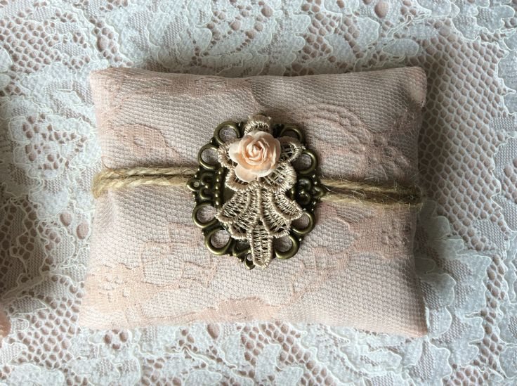 Handmade lavender mini pillows decorated with lace and vintage style embellishments. filled with dried lavender from the Cotswolds.
