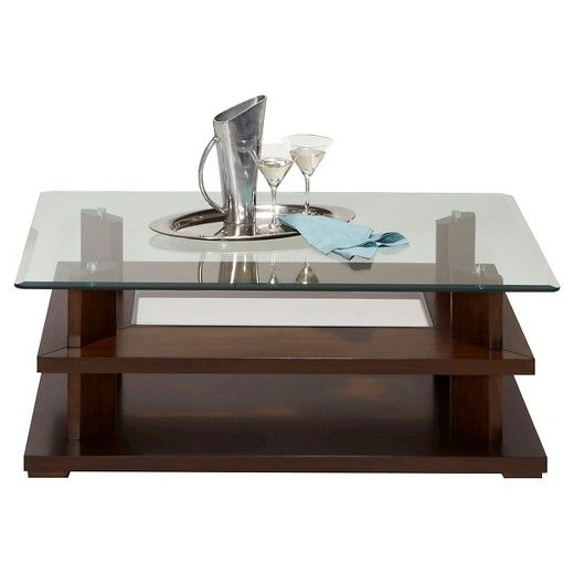This contemporary cocktail table gives you a gorgeous dark cherry finish with the wood and the glass top for a touch of elegance. Easy to clean with two additional shelving for storage.