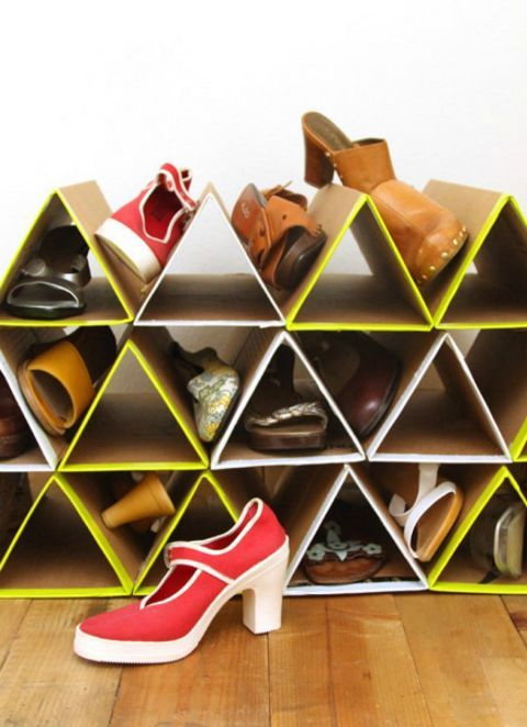 Don't buy more bulky racks to store flats, sneakers, and sandals. Instead, DIY this stackable cardboard box rack (you can spray paint it for a pop of color) so you can add to it as your collection grows.  Get the tutorial here.