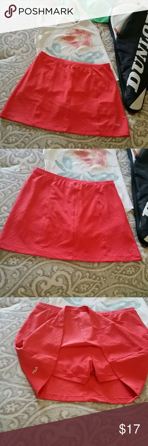 Fila Skort Perfect used condition. Color looks brighter on pics, it's not neon, more of a beautiful salmon (orange with pink) color. Great for tennis, pickle ball,  jogging, or anything you do and want to be super comfortable and cute. Fila Shorts Skorts