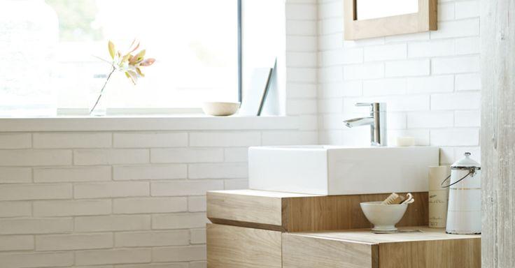 White brick tiles and blonde wood - scandi style bathroom.