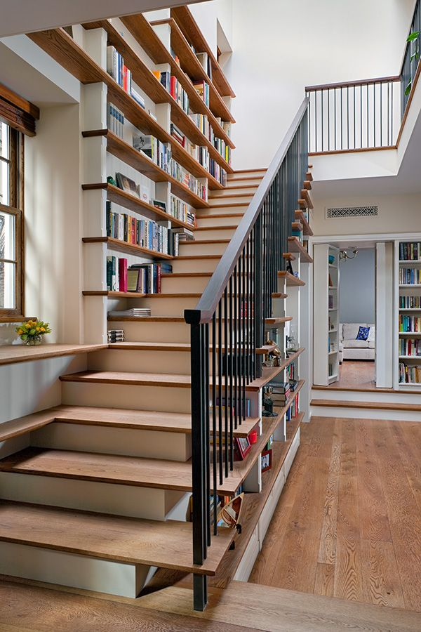 Staircase Bookshelves Above And Below The Stairs From
