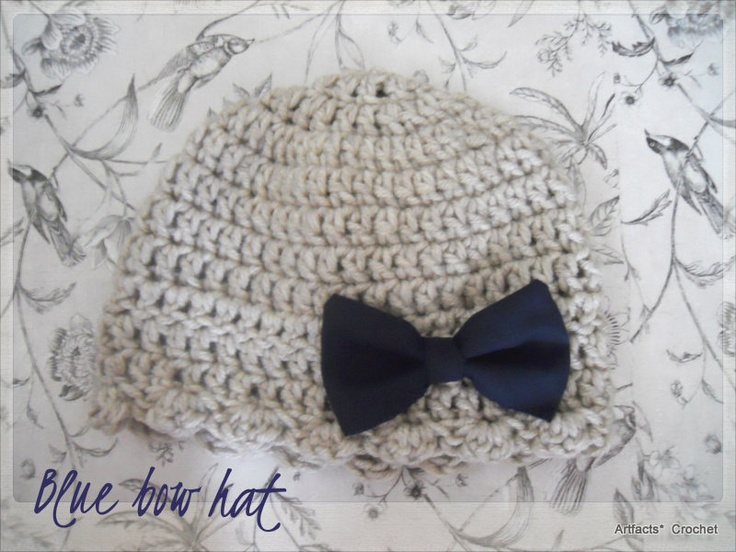 crochet hat with blue bow