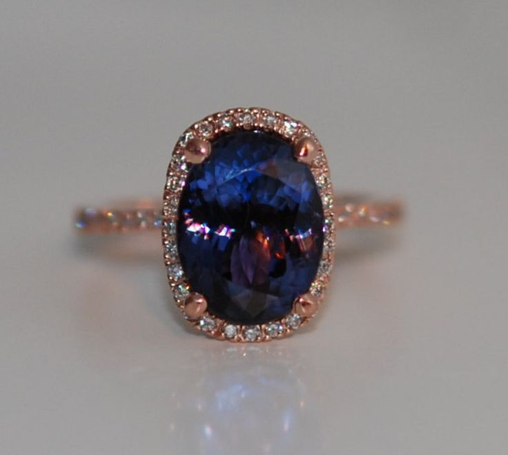 Tanzanite ring. Rose gold engagement ring. Eidelprecious ring.  This Tanzanite is natural cushion cut stone. #wedding #weddinginspiration