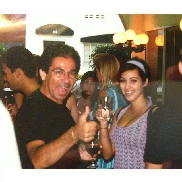 Kim Kardashian & dad, Kourtney in background
