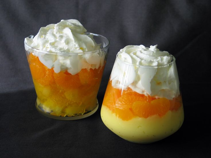 A healthier option for halloween treats.. pineapple on bottom, oranges in the middle, topped with whipped cream.