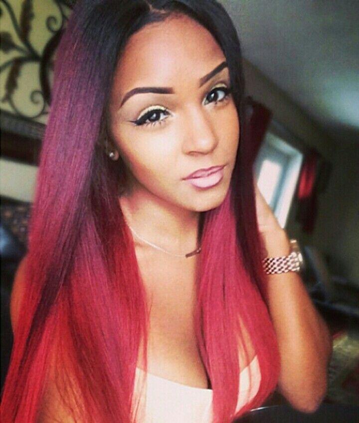 Purple red and orange hair color on black or hispanic ...