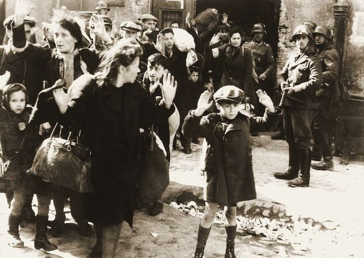 Iconic Photos Of The 1940s: Warsaw Ghetto Uprising, 1943. Shot in 1943, this is one of the best-known pictures of World War Two, as it depicts the terror inspired by the Nazis. The image shows the destruction of the Warsaw Ghetto, which was home to thousands of Jewish citizens escaping the Nazi regime. Though the most poignant part of picture is the frightened little boy in the foreground with his hands up as he is forcibly removed from his hiding place.