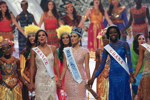 Megan Young Photos Photos - Miss World 2013, Megan Young (C) from the Philippines, sings with runner-up Miss France, Marine Lorphelin (L) and second runner-up Miss Ghana, Carranzar Naa Okailey Shooter (R) after Young was crowned  Miss World 2013 during the Miss World 2013 final on September 28, 2013 in Nusa Dua, Indonesia. - Miss World 2013 Final