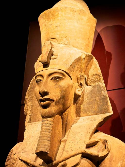 Statue of AKHENATEN - Father of TUTANKHAMUN (CC BY-SA 2.0) One of the first things he did was abandon the name Amen-, a name associated with a god he now despised – and changed his name to AKHENATEN. ATEN was the name of the sun disk god he now embraced as the only god. He then moved the capital from THEBES to AMARNA.