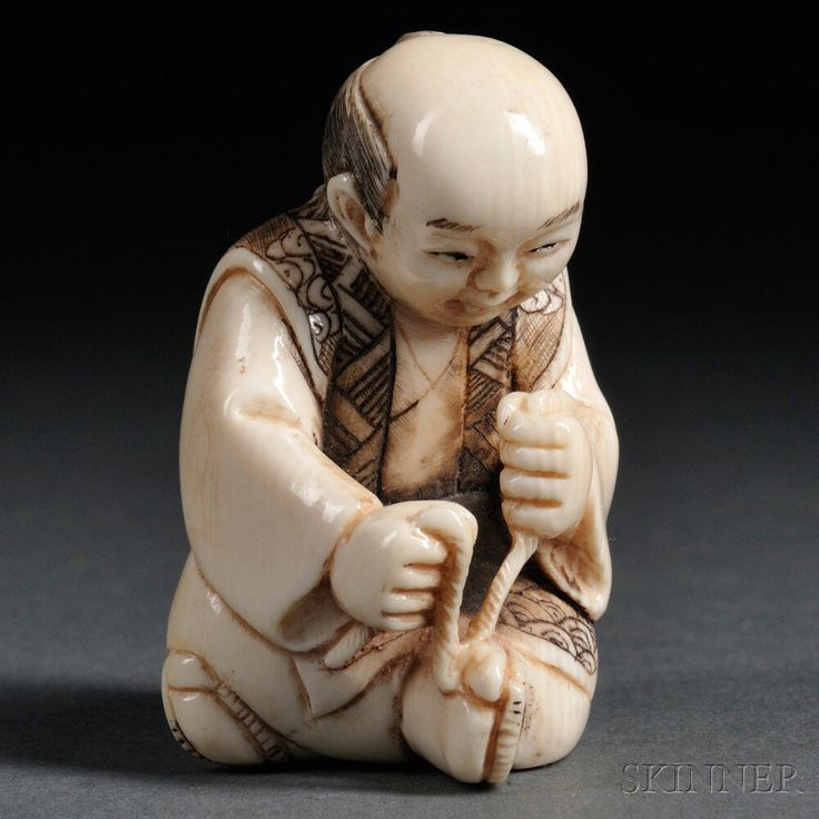 Ivory Netsuke of a Man, Japan, 19th century, sitting cross-legged on the ground, tying a lace on his right shoe, signed on base, ht. 1 5/8 in.