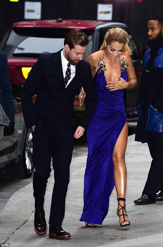 Steady on there: Rita Ora struggled to contain her assets as she arrived at the television launch of The Voice UK in London on Monday