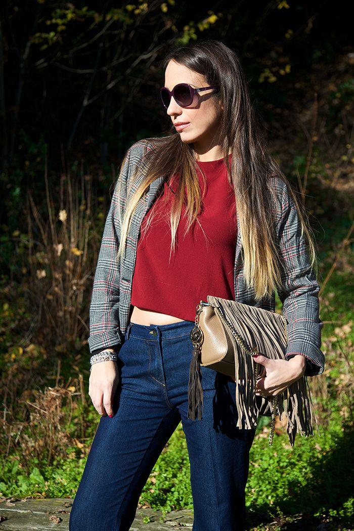 Blazer - Burgundy crop top - Flared jeans - Fringe bag